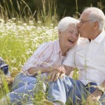 Senior couple sitting together outdoors