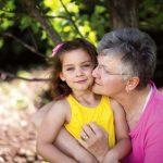 Grandma embracing granddaughter